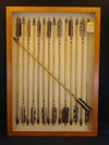A frame of 15 fletched Hupa-Yurok wooden arrows