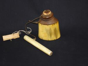 An Eskimo horn and wood snuff container