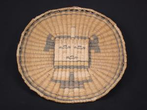 A Hopi wicker tray decorated with a  Kachina
