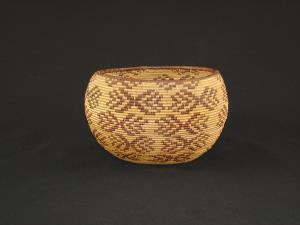 A Maidu basket decorated with butterflies