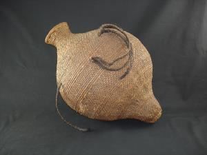 A Paiute seed jar with horse hair handles