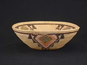 A Panamint bowl with designs in pink, yellow and blue
