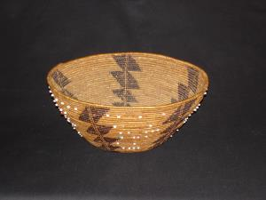 An early Pomo bowl with beads