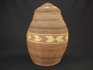 A very large and nice Siletz basket with decorated cover