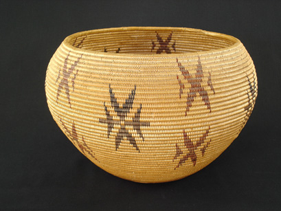 A large and rare Washoe polychrome snowflake decorated basket